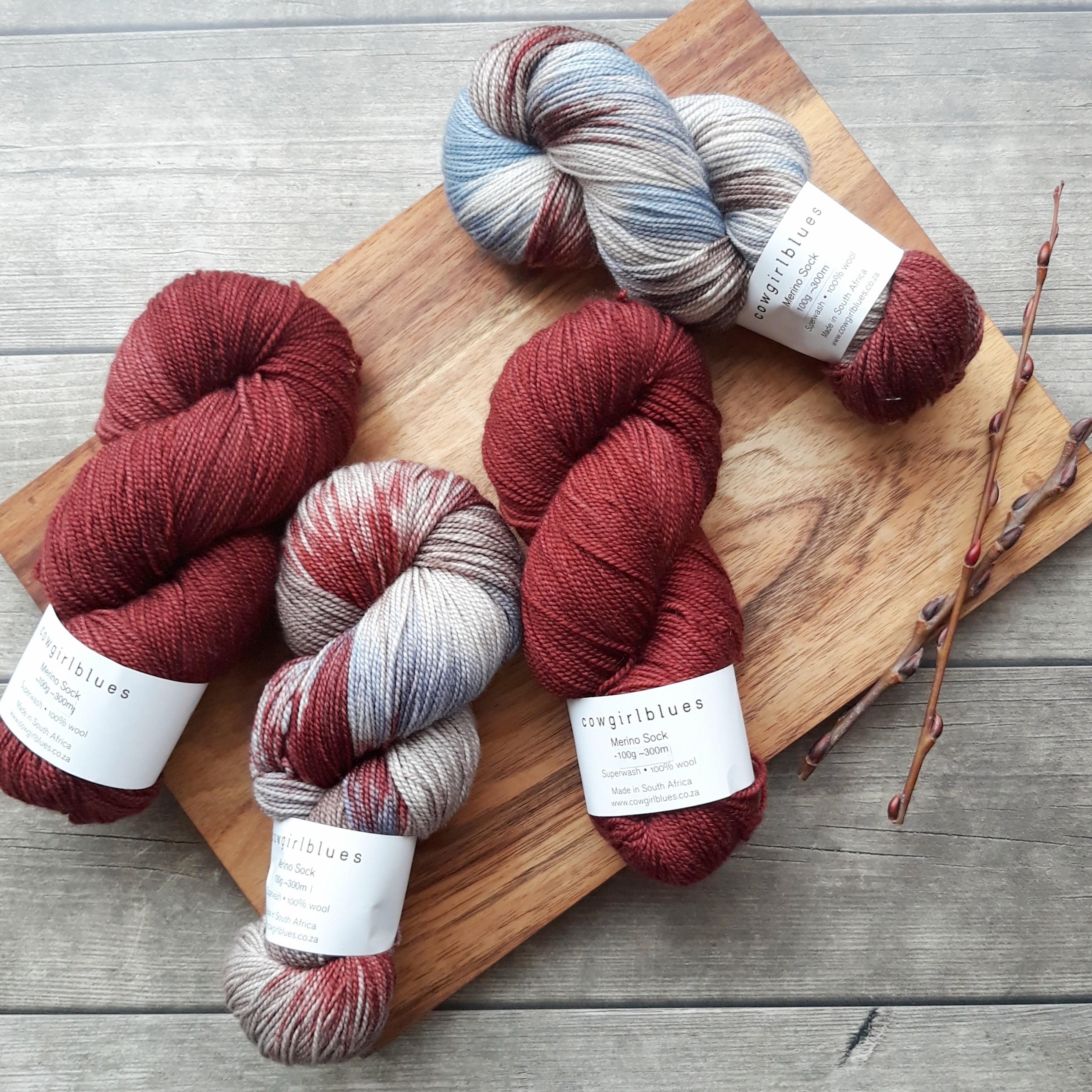 red yarn on a cuttig board