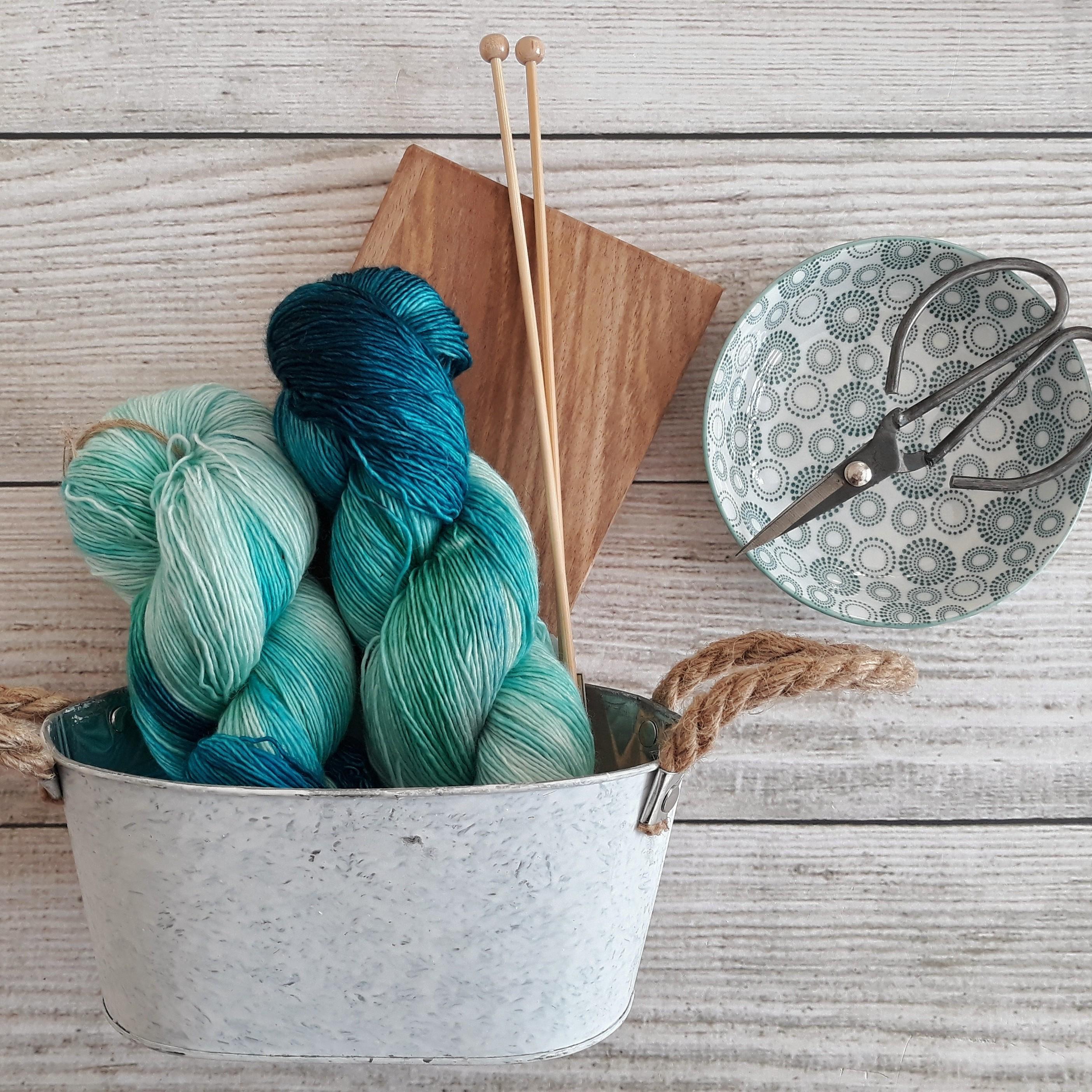 blue yarn in a tin bucket
