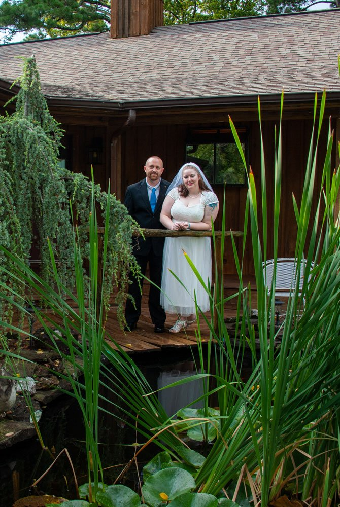 groom and bride across a pond