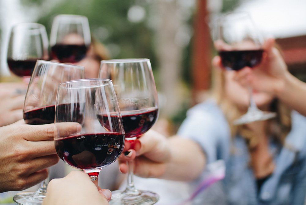 group toasting wine glasses