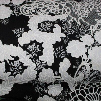 Black-/white lacy print