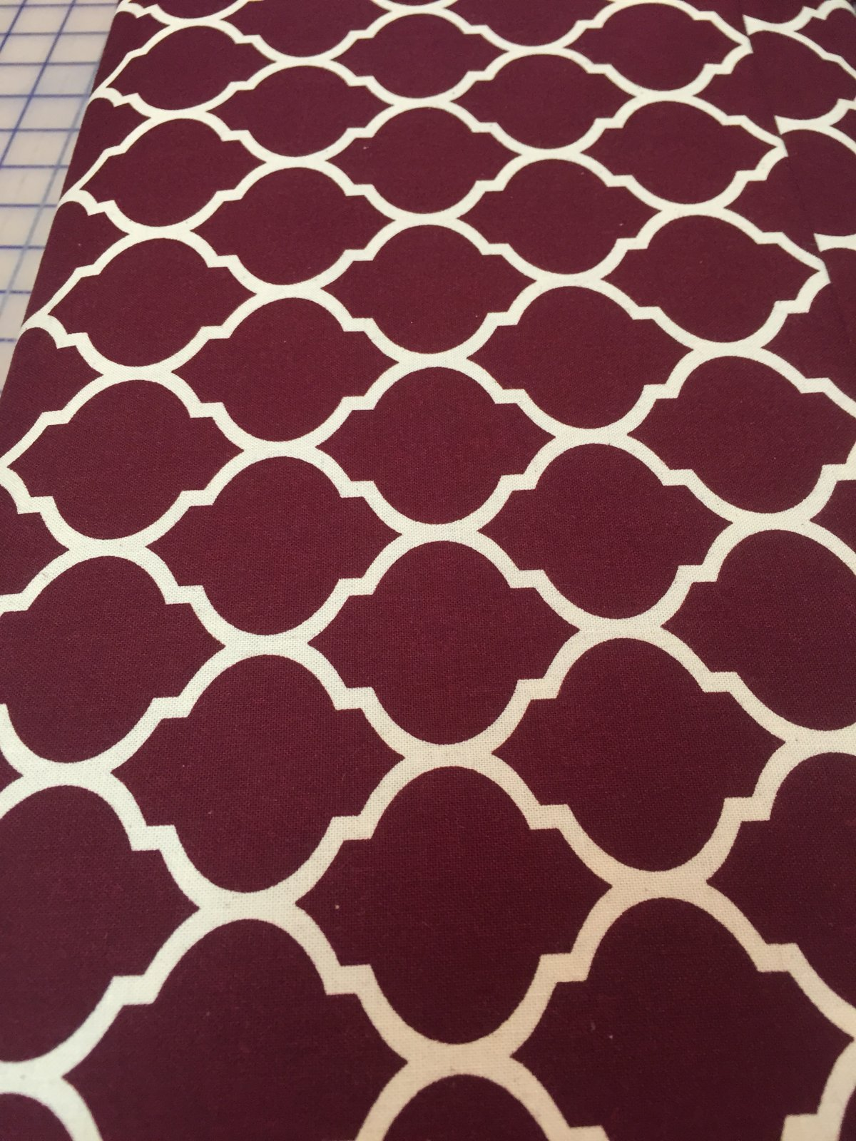 Maroon with off white wrought iron