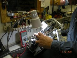 Technitian Repairing a Sewing Machine