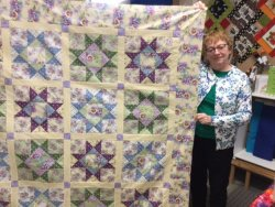 beautiful purple and green star quilt