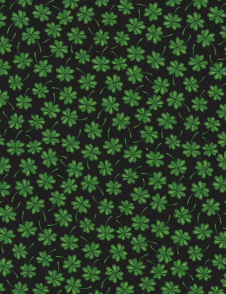 Four leaf clovers on black