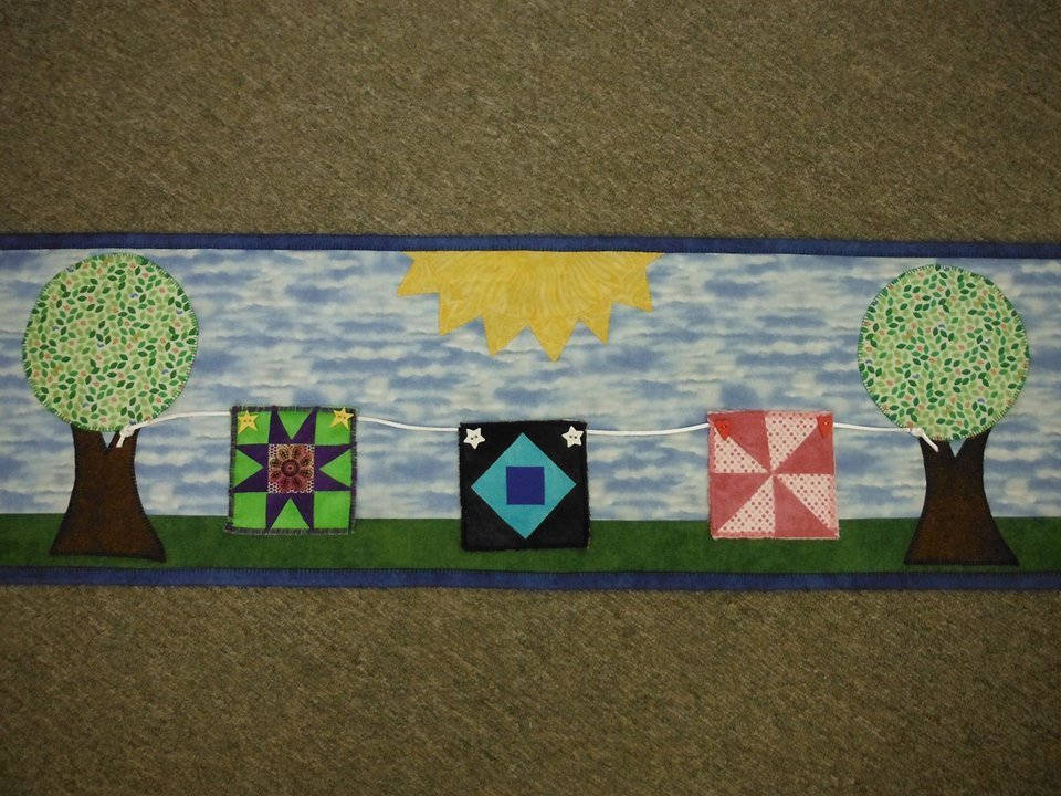 Row by Row Quilts Hanging in Summer Breeze 2014  Pattern Only