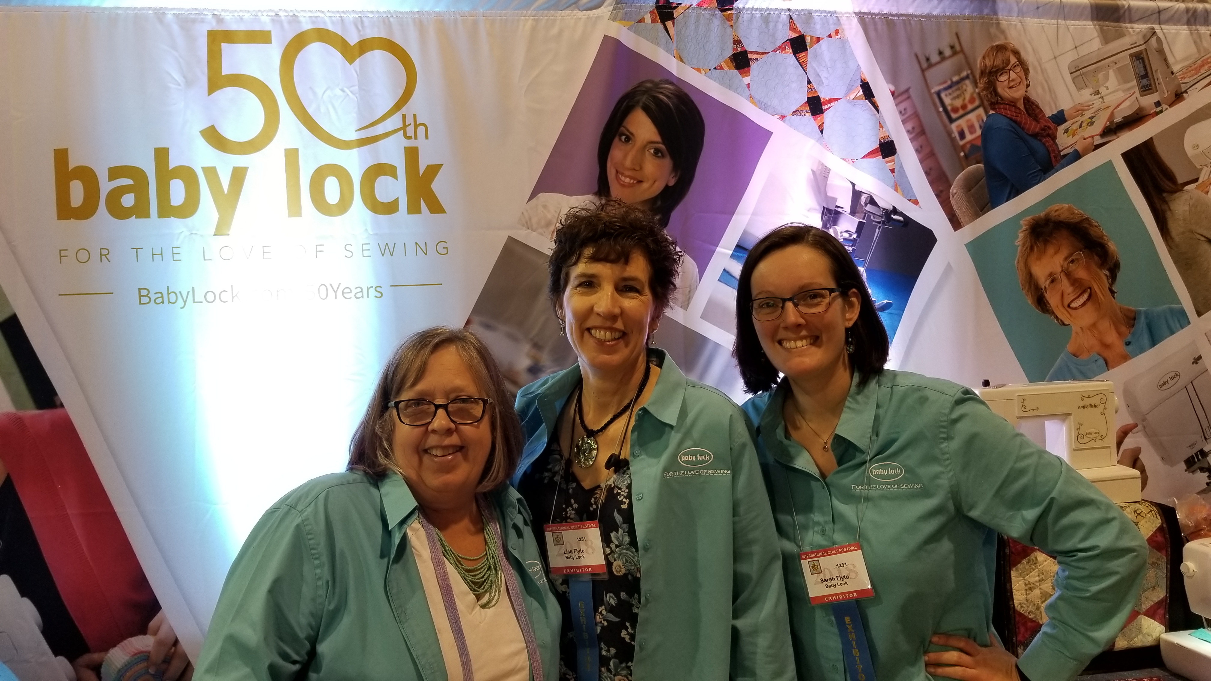 group photo at Baby Lock booth