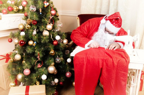 Santa with sewing machine