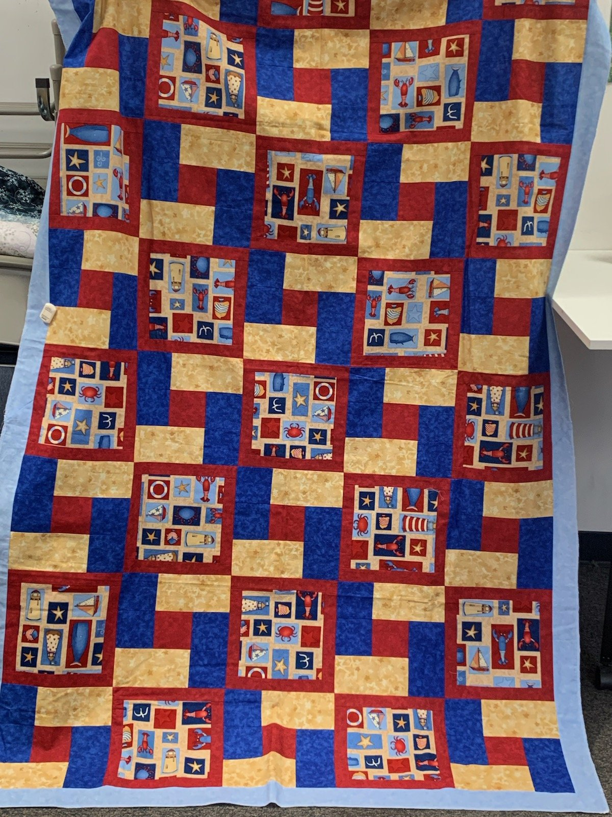 Nautical Top with Binding  Measures 48 x 76 inches