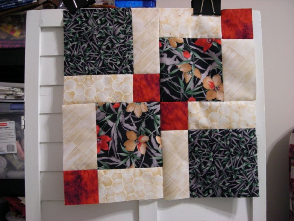 Disappearing nine patch quilt pattern.