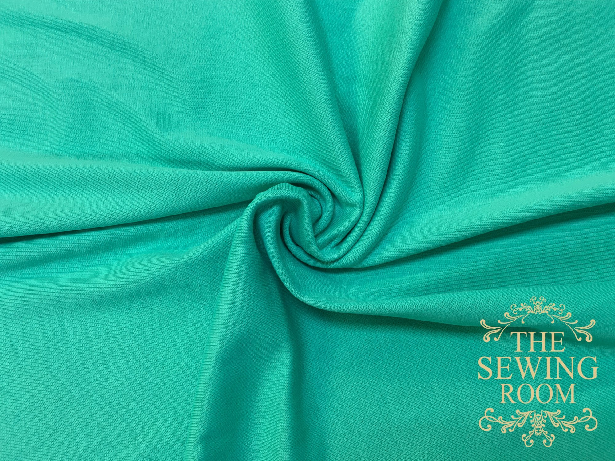 Green Cotton Interlock Knit Fabric by M and M Fabric