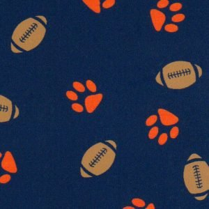 Orange Paws & Footballs on Navy Fabric by Fabric Finders