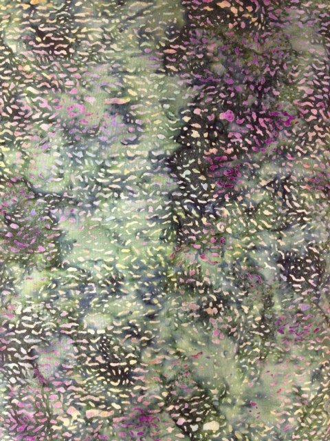 Island Batik  Medium green with small flecks of tan and purple with areas of darker green