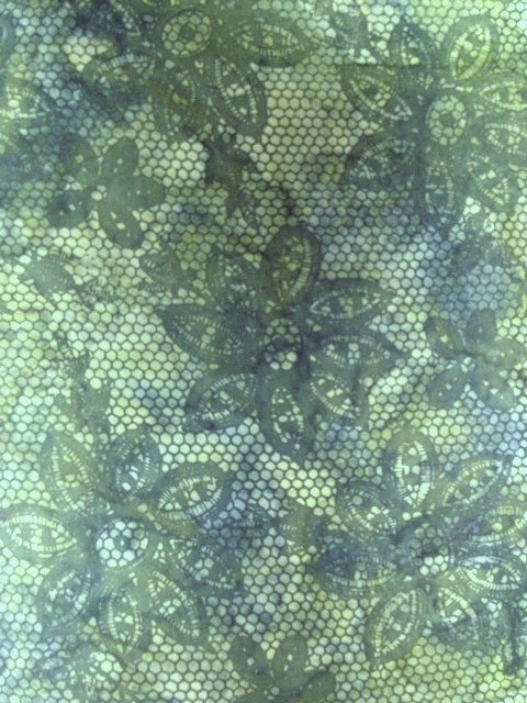 Island Batik, medium green background with overprint of darker green lace and floral design