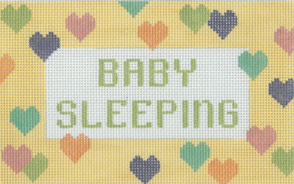 Baby Sleeping on Yellow with Hearts
