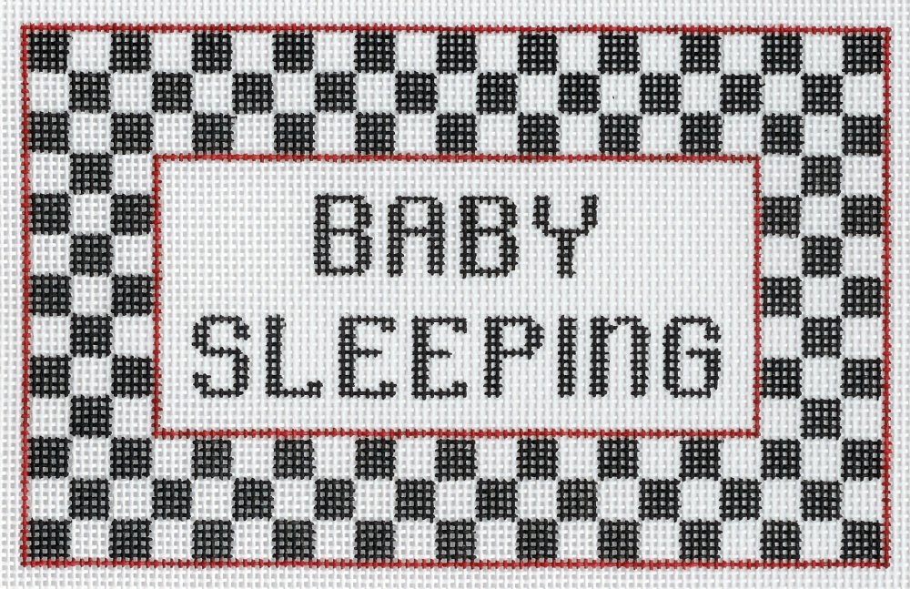 Baby Sleeping with Black & White Checks
