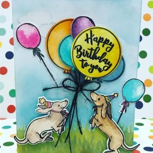 Card with dogs holding balloons that says Happy Birthday to You