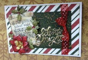 Christmas Card With a Bow, Music Sheet, and Flowers on it
