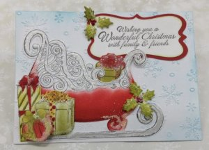 Christmas Card With Santa's Sleigh and Gifts on it