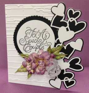 Wedding Card With a Flower, Black & White Hearts, and Two Rings