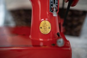 Singer Featherweight 221 painted red badge detail