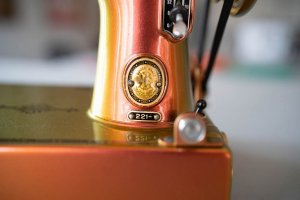 Singer Featherweight 221 painted color changing bronze badge
