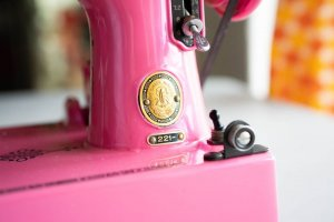Singer Featherweight 221 painted pink badge