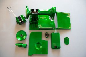 Singer Featherweight 221 painted green metallic candy apple parts arrayed