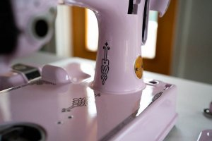 Singer Featherweight 221 painted pale pastel pink bed