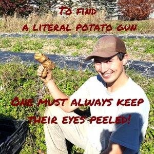 A man holding a potato gun