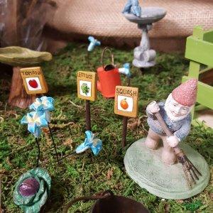 Fairy planting a garden
