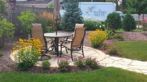 Patio in garden with table and chairs