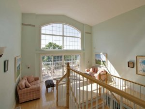 sitting area with vaulted windows