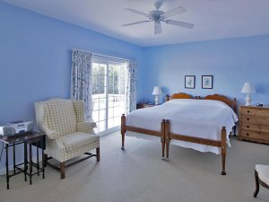 blue bedroom with large bed