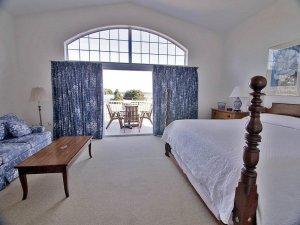 bedroom with open doors to deck