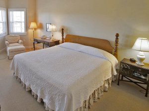 large bed with bedside lamps