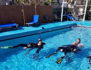 Dive staff practicing in-water rescue.