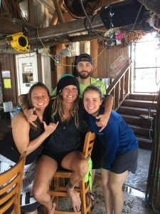 Instructor and happy divers at the Tiki Bar after diving.
