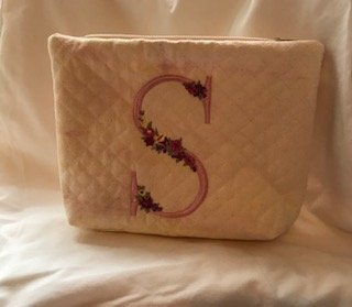 Letter quilted cosmetic bag