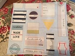 Quilt Labels (Rolled up in metal bus)