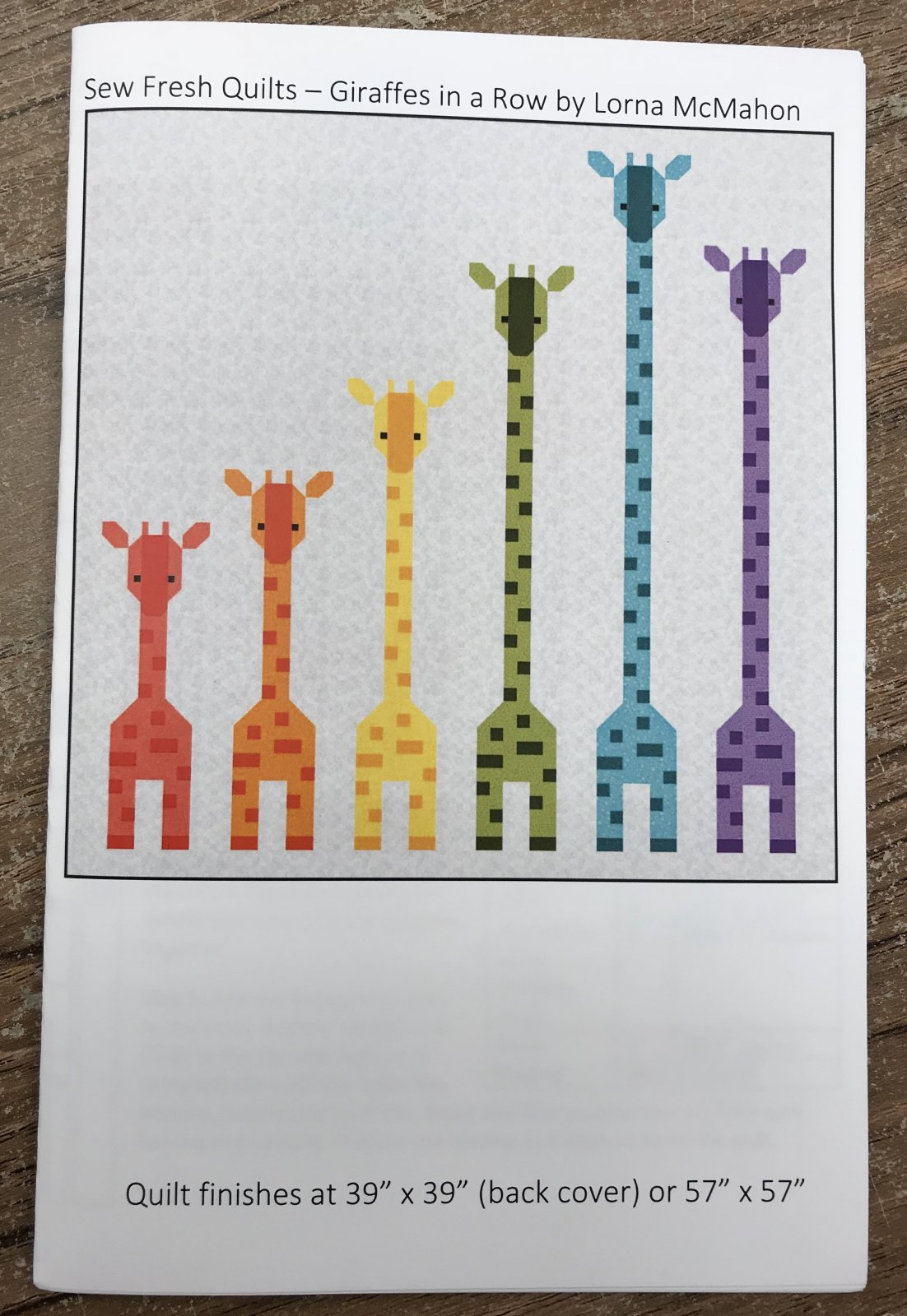 Giraffes in a Row by Lorna McMahon