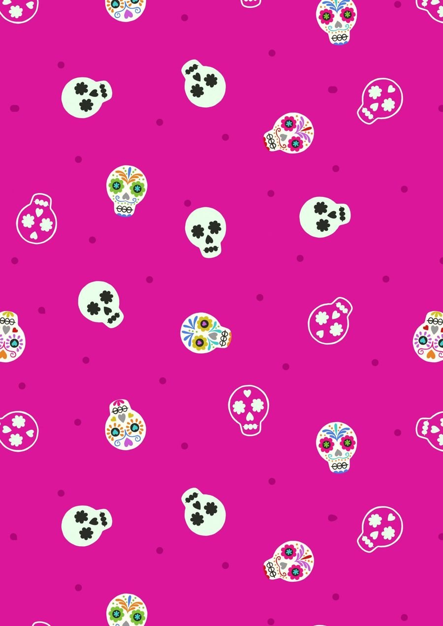 Small Things Glow - Sugar Skulls on Bright Pink by Lewis & Irene Fabrics