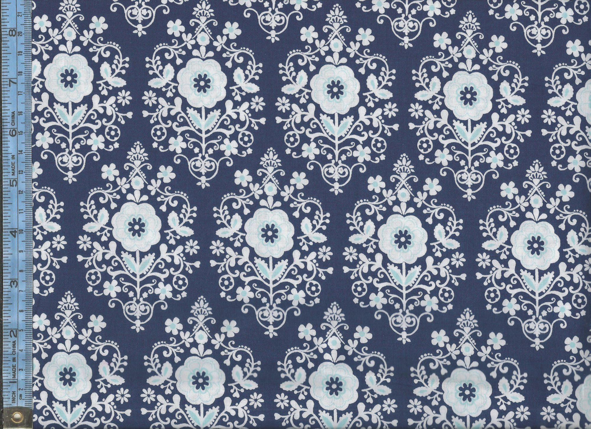 butter cream light blue and white floral damask design on navy