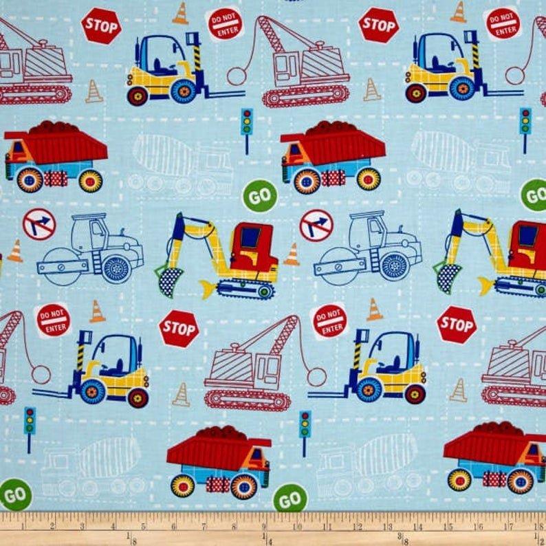 Construction Trucks on Blue