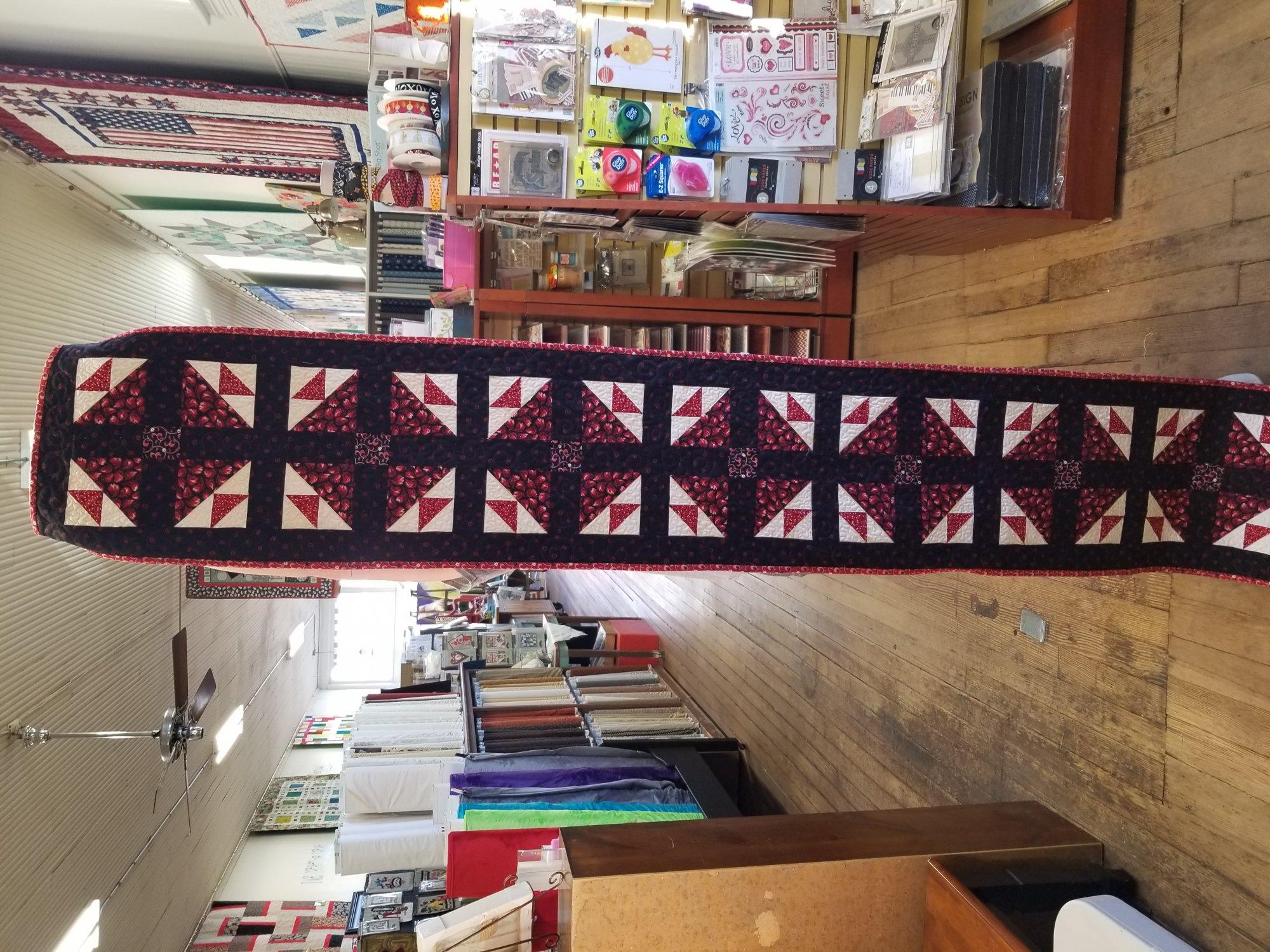 Red and Black Hen & Chicks Long Table Runner Store Sample