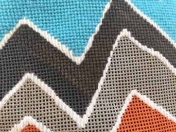 dark needlepoint canvas with dark threads