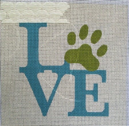 needlepoint heart darning pattern on love canvas with animal print paw in blue and green