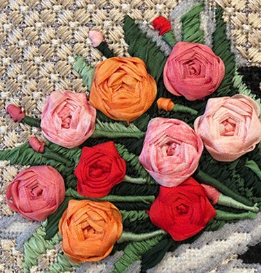 Floral bouquet of spider web needlepoint stitches