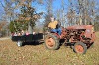 Steve pulling grandchildren in wagon 2014 Christmas