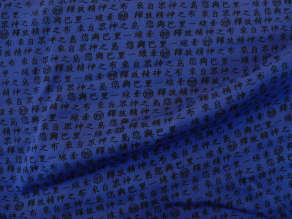 100% rayon batik, navy with black lettering